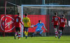 SOUTHAMPTON, ENGLAND - JANUARY 18: Oliver Wright of Southampton FC makes a save with his feet during the Barclays Under 18 Premier League match between Southampton FC and Arsenal FC at the Staplewood Campus on January 18, 2020 in Southampton, England