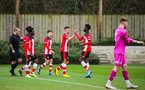 SOUTHAMPTON, ENGLAND - JANUARY 23: Jack Turner of Southampton FC (C) celebrates with teammates after scoring his second goal and his side's third goal during the Barclays Under 18 Premier League match between Southampton FC and Swansea City at the Staplewood Campus on January 23, 2020 in Southampton, England