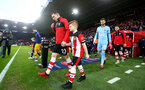 SOUTHAMPTON, ENGLAND - JANUARY 25: Pierre-Emile Hojbjerg of Southampton leads the teams out with the match day mascot during the FA Cup Fourth Round match between Southampton FC and Tottenham Hotspur at St. Mary's Stadium on January 25, 2020 in Southampton, England. (Photo by Matt Watson/Southampton FC via Getty Images)