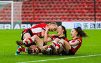 SOUTHAMPTON, ENGLAND - JANUARY 26: Rachel Panting of Southampton Womens FC (C) celebrates with Rachel Woods (L) and Ella Morris (R) after scoring her side's first goal during the Women's FA Cup Fourth Round match between Southampton Womens FC and Coventry United Ladies at St Mary's Stadium on January 26, 2020 in Southampton, England