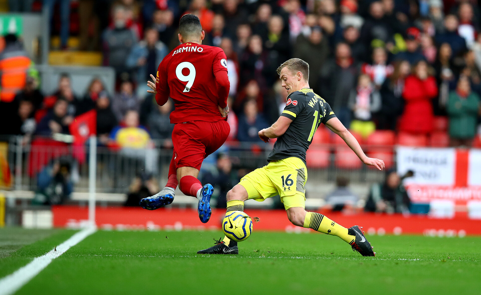 LIVERPOOL, ENGLAND - FEBRUARY 01: Roberto Firminho(L) of Liverpool is tackled by James Ward-Prowse of Southampton during the Premier League match between Liverpool FC and Southampton FC at Anfield on February 01, 2020 in Liverpool, United Kingdom. (Photo by Matt Watson/Southampton FC via Getty Images)
