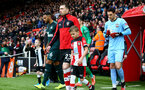 SOUTHAMPTON, ENGLAND - MARCH 07: Pierre-Emile Højbjerg of Southampton leads the teams out with the match day mascot during the Premier League match between Southampton FC and Newcastle United at St Mary's Stadium on March 07, 2020 in Southampton, United Kingdom. (Photo by Matt Watson/Southampton FC via Getty Images)