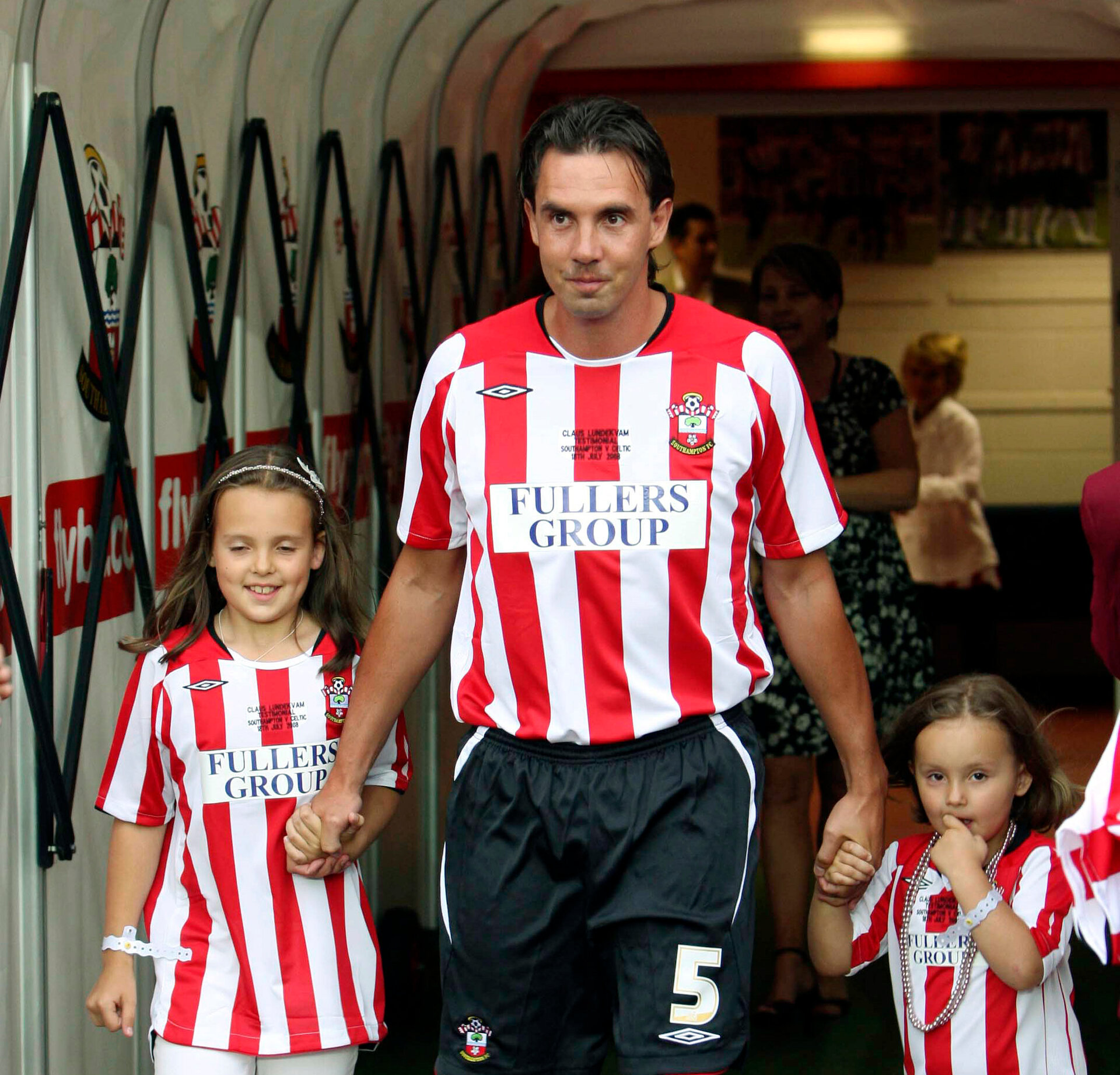Football - Southampton v Celtic - Claus Lundekvam Testimonial  - St Mary's Stadium - 18/7/08  Southampton's Claus Lundekvam walks out of the tunnel with his children  Mandatory Credit: Action Images / Lee Mills  Livepic