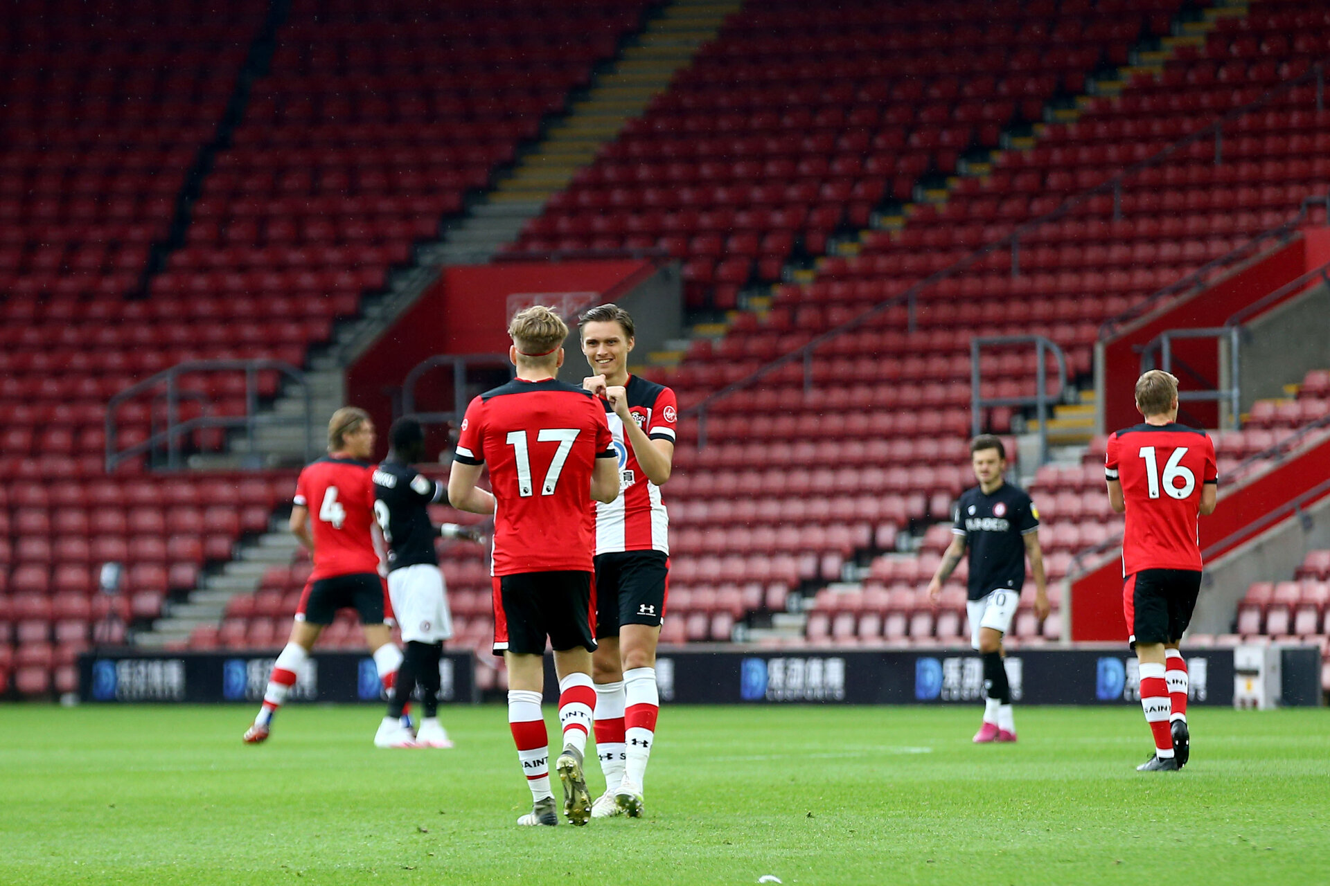 SOUTHAMPTON, ENGLAND - JUNE 12: Stuart Armstrong (L) and Will Smallbone (R) during a friendly match between Southampton FC and Bristol City, ahead of the Premier League re-start, at St Mary's Stadium on June 12, 2020 in Southampton, England. (Photo by Matt Watson/Southampton FC via Getty Images)