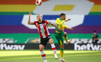NORWICH, ENGLAND - JUNE 19: (L) Pierre-Emile Hojbjerg and Emiliano Buendil (R)  during the Premier League match between Norwich City and Southampton FC at Carrow Road on June 19, 2020 in Norwich, United Kingdom. (Photo by Matt Watson/Southampton FC via Getty Images)