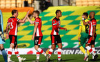 NORWICH, ENGLAND - JUNE 19: (L)Pierre-Emile Hojbjerg, Stuart Armstrong, Yan Valery and (R) Nathan Redmond celebrating Armstrong's goal during the Premier League match between Norwich City and Southampton FC at Carrow Road on June 19, 2020 in Norwich, United Kingdom. (Photo by Matt Watson/Southampton FC via Getty Images)