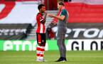 SOUTHAMPTON, ENGLAND - JUNE 25: (L) Ryan Bertrand and (R) Ralph Hasenhuttl during the Premier League match between Southampton FC and Arsenal FC at St Mary's Stadium on March 21, 2020 in Southampton, United Kingdom. (Photo by Matt Watson/Southampton FC via Getty Images)