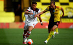 WATFORD, ENGLAND - JUNE 28: (L) Ché Adams and (R) Craig Cathcart during the Premier League match between Watford FC and Southampton FC at Vicarage Road on April 4, 2020 in Watford, United Kingdom. (Photo by Matt Watson/Southampton FC via Getty Images)