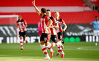 SOUTHAMPTON, ENGLAND - JULY 05: Ché Adams (L) and Danny Ings (R) clebrating Ché Adams goal during the Premier League match between Southampton FC and Manchester City at St Mary's Stadium on July 5, 2020 in Southampton, United Kingdom. Football Stadiums around Europe remain empty due to the Coronavirus Pandemic as Government social distancing laws prohibit fans inside venues resulting in games being played behind closed doors. (Photo by Matt Watson/Southampton FC via Getty Images)