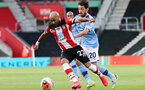 SOUTHAMPTON, ENGLAND - JULY 05: Nathan Redmond (L) and Bernardo Silva (R) during the Premier League match between Southampton FC and Manchester City at St Mary's Stadium on July 5, 2020 in Southampton, United Kingdom. Football Stadiums around Europe remain empty due to the Coronavirus Pandemic as Government social distancing laws prohibit fans inside venues resulting in games being played behind closed doors. (Photo by Chris Moorhouse/Southampton FC via Getty Images)