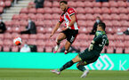 SOUTHAMPTON, ENGLAND - JULY 05: Ché Adams (L) and Ederson (R)  during the Premier League match between Southampton FC and Manchester City at St Mary's Stadium on July 5, 2020 in Southampton, United Kingdom. Football Stadiums around Europe remain empty due to the Coronavirus Pandemic as Government social distancing laws prohibit fans inside venues resulting in games being played behind closed doors. (Photo by Chris Moorhouse/Southampton FC via Getty Images)