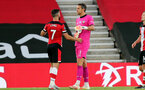 SOUTHAMPTON, ENGLAND - JULY 05: Shane Long (L) and Alex McCarthy (R) during the Premier League match between Southampton FC and Manchester City at St Mary's Stadium on July 5, 2020 in Southampton, United Kingdom. Football Stadiums around Europe remain empty due to the Coronavirus Pandemic as Government social distancing laws prohibit fans inside venues resulting in games being played behind closed doors. (Photo by Chris Moorhouse/Southampton FC via Getty Images)
