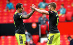 MANCHESTER, ENGLAND - JULY 13: Stuart Armstrong(R) of Southampton celebrates with Danny Ings after scoring during the Premier League match between Manchester United and Southampton FC at Old Trafford on July 13, 2020 in Manchester, United Kingdom. Football Stadiums around Europe remain empty due to the Coronavirus Pandemic as Government social distancing laws prohibit fans inside venues resulting in all fixtures being played behind closed doors. (Photo by Matt Watson/Southampton FC via Getty Images)