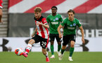 SOUTHAMPTON, ENGLAND - JULY 16: Jake Vokins (L) of southampton and Leandro Trossard (R) of Brighton during the Premier League match between Southampton FC and Brighton & Hove Albion at St Mary's Stadium on July 16, 2020 in Southampton, United Kingdom. Football Stadiums around Europe remain empty due to the Coronavirus Pandemic as Government social distancing laws prohibit fans inside venues resulting in all fixtures being played behind closed doors. (Photo by Chris Moorhouse/Southampton FC via Getty Images)