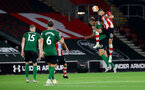 SOUTHAMPTON, ENGLAND - JULY 16: Jan Bednarek of Southampton wins a header during the Premier League match between Southampton FC and Brighton & Hove Albion at St Mary's Stadium on July 16, 2020 in Southampton, United Kingdom. Football Stadiums around Europe remain empty due to the Coronavirus Pandemic as Government social distancing laws prohibit fans inside venues resulting in all fixtures being played behind closed doors. (Photo by Matt Watson/Southampton FC via Getty Images)