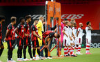 BOURNEMOUTH, ENGLAND - JULY 19: both teams ahead of the Premier League match between AFC Bournemouth and Southampton FC at Vitality Stadium on July 19, 2020 in Bournemouth, United Kingdom. Football Stadiums around Europe remain empty due to the Coronavirus Pandemic as Government social distancing laws prohibit fans inside venues resulting in all fixtures being played behind closed doors. (Photo by Matt Watson/Southampton FC via Getty Images)