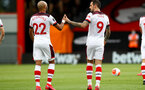 BOURNEMOUTH, ENGLAND - JULY 19: Nathan Redmond (L) and Danny Ings (R) celebrating Danny Ings goal during the Premier League match between AFC Bournemouth and Southampton FC at Vitality Stadium on July 19, 2020 in Bournemouth, United Kingdom. Football Stadiums around Europe remain empty due to the Coronavirus Pandemic as Government social distancing laws prohibit fans inside venues resulting in all fixtures being played behind closed doors. (Photo by Matt Watson/Southampton FC via Getty Images)