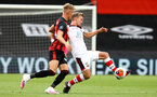BOURNEMOUTH, ENGLAND - JULY 19: Dan Gosling (L) of bournemouth and James Ward-Prowse (R) of southampton during the Premier League match between AFC Bournemouth and Southampton FC at Vitality Stadium on July 19, 2020 in Bournemouth, United Kingdom. Football Stadiums around Europe remain empty due to the Coronavirus Pandemic as Government social distancing laws prohibit fans inside venues resulting in all fixtures being played behind closed doors. (Photo by Matt Watson/Southampton FC via Getty Images)