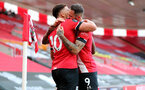 SOUTHAMPTON, ENGLAND - JULY 26: Ché Adams (L) and Danny Ings (R) celebrating Ché Adams goal during the Premier League match between Southampton FC and Sheffield United at St Mary's Stadium on April 17, 2020 in Southampton, United Kingdom. (Photo by Chris Moorhouse/Southampton FC via Getty Images)