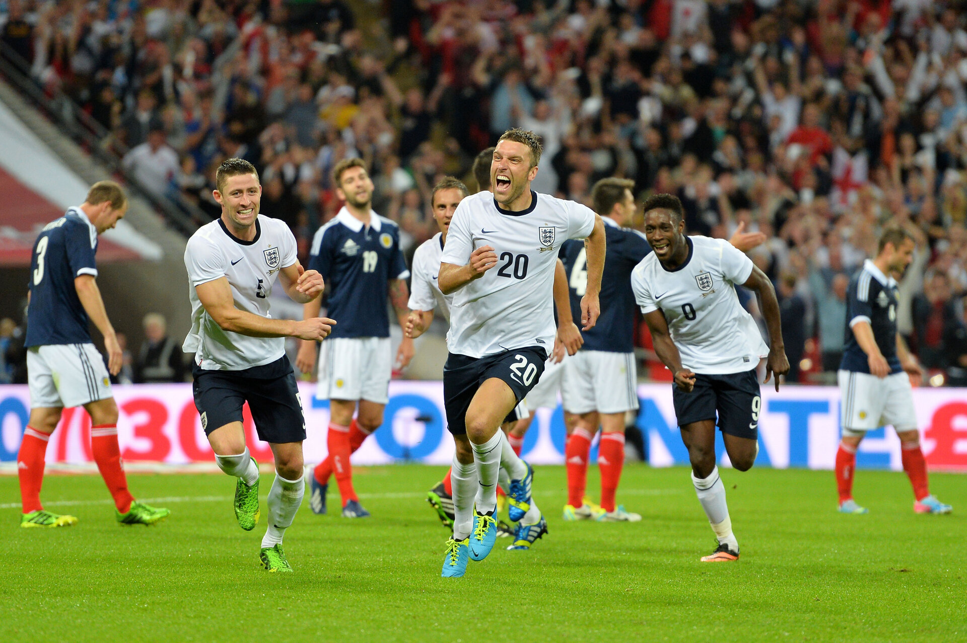 LONDON, ENGLAND - AUGUST 14:  Rickie Lambert of England (C) celebrates with team-mates Gary Cahill of England (L) and Danny Welbeck of England (R) after scoring a goal during the International Friendly match between England and Scotland at Wembley Stadium on August 14, 2013 in London, England.  (Photo by Mike Hewitt/Getty Images)
