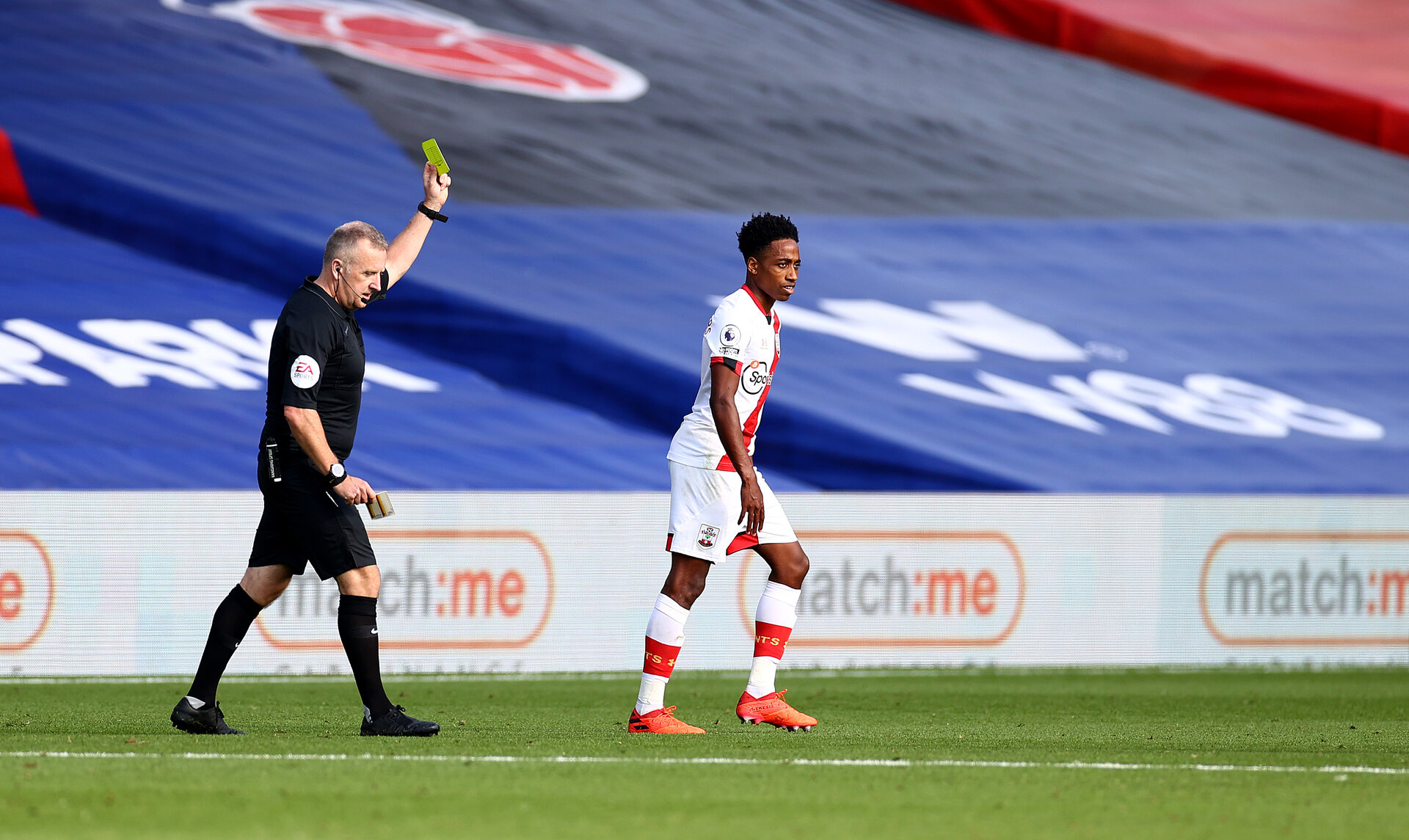 LONDON, ENGLAND - SEPTEMBER 12: Kyle Walker-Peters of Southampton is shown a yellow card during the Premier League match between Crystal Palace and Southampton at Selhurst Park on September 12, 2020 in London, United Kingdom. (Photo by Matt Watson/Southampton FC via Getty Images)
