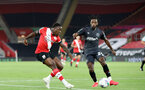 SOUTHAMPTON, ENGLAND - SEPTEMBER 16: Michael Obafemi (L) of Southampton during the second round of the Carabao Cup match between Southampton FC and Brentford FC at St. Mary's Stadium on September 16, 2020 in Southampton, England. (Photo by Chris Moorhouse/Southampton FC via Getty Images)