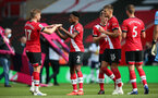 SOUTHAMPTON, ENGLAND - SEPTEMBER 20: Stuart Armstrong and Kyle Walker-Peters during the Premier League match between Southampton and Tottenham Hotspur at St Mary's Stadium on September 20, 2020 in Southampton, United Kingdom. (Photo by Chris Moorhouse/Southampton FC via Getty Images)