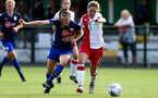 SOUTHAMPTON, ENGLAND - SEPTEMBER 20: Ella Pusey (L) of Southampton batteling for the ball during the FAWNL match between Southampton Women and Poole Town FC at Specsavers County Ground on September 20, 2020 in Poole, England. (Photo by Isabelle Field/Southampton FC via Getty Images)