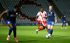 STEVENAGE, ENGLAND - SEPTEMBER 22: Callum Slattery (R) of Southampton passing to Dan N'Lundulu (L) of Southampton during the EFL Trophy match between Stevenage FC and Southampton FC B Team  at the Lamex Stadium on September 22, 2020 in Stevenage, England. (Photo by Isabelle Field/Southampton FC via Getty Images)
