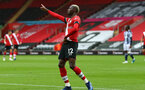 SOUTHAMPTON, ENGLAND - OCTOBER 04: Moussa Djenepo of Southampton goal celebration during the Premier League match between Southampton and West Bromwich Albion at St Mary's Stadium on October 4, 2020 in Southampton, United Kingdom. Sporting stadiums around the UK remain under strict restrictions due to the Coronavirus Pandemic as Government social distancing laws prohibit fans inside venues resulting in games being played behind closed doors. (Photo by Matt Watson/Southampton FC via Getty Images)