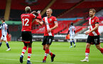 SOUTHAMPTON, ENGLAND - OCTOBER 04: Moussa Djenepo (L) celebrates first goal with captain James Ward-Prowse (R) of Southampton during the Premier League match between Southampton and West Bromwich Albion at St Mary's Stadium on October 4, 2020 in Southampton, United Kingdom. Sporting stadiums around the UK remain under strict restrictions due to the Coronavirus Pandemic as Government social distancing laws prohibit fans inside venues resulting in games being played behind closed doors. (Photo by Matt Watson/Southampton FC via Getty Images)