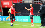 SOUTHAMPTON, ENGLAND - OCTOBER 04: Moussa Djenepo (L) coming off for Nathan Redmond (R) of Southampton  during the Premier League match between Southampton and West Bromwich Albion at St Mary's Stadium on October 4, 2020 in Southampton, United Kingdom. Sporting stadiums around the UK remain under strict restrictions due to the Coronavirus Pandemic as Government social distancing laws prohibit fans inside venues resulting in games being played behind closed doors. (Photo by Matt Watson/Southampton FC via Getty Images)