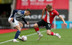 SOUTHAMPTON, ENGLAND - OCTOBER 04: Conor Townsend (L) of West Bromwich Albion and Stuart Armstrong (R) of Southampton during the Premier League match between Southampton and West Bromwich Albion at St Mary's Stadium on October 4, 2020 in Southampton, United Kingdom. Sporting stadiums around the UK remain under strict restrictions due to the Coronavirus Pandemic as Government social distancing laws prohibit fans inside venues resulting in games being played behind closed doors. (Photo by Matt Watson/Southampton FC via Getty Images)