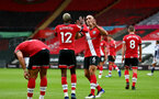 SOUTHAMPTON, ENGLAND - OCTOBER 04: Oriol Romeu (R) congratulates Moussa Djenepo (L) on his goal during the Premier League match between Southampton and West Bromwich Albion at St Mary's Stadium on October 4, 2020 in Southampton, United Kingdom. Sporting stadiums around the UK remain under strict restrictions due to the Coronavirus Pandemic as Government social distancing laws prohibit fans inside venues resulting in games being played behind closed doors. (Photo by Matt Watson/Southampton FC via Getty Images)