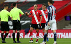SOUTHAMPTON, ENGLAND - OCTOBER 04: Oriol Romeu (L) of Southampton pist pumping match officals after the Premier League match between Southampton and West Bromwich Albion at St Mary's Stadium on October 4, 2020 in Southampton, United Kingdom. Sporting stadiums around the UK remain under strict restrictions due to the Coronavirus Pandemic as Government social distancing laws prohibit fans inside venues resulting in games being played behind closed doors. (Photo by Matt Watson/Southampton FC via Getty Images)