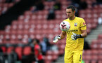 SOUTHAMPTON, ENGLAND - OCTOBER 04: Alex McCarthy during the Premier League match between Southampton and West Bromwich Albion at St Mary's Stadium on October 4, 2020 in Southampton, United Kingdom. Sporting stadiums around the UK remain under strict restrictions due to the Coronavirus Pandemic as Government social distancing laws prohibit fans inside venues resulting in games being played behind closed doors. (Photo by Chris Moorhouse/Southampton FC via Getty Images)