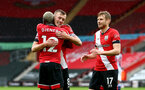 SOUTHAMPTON, ENGLAND - OCTOBER 04: Moussa Djenepo(L) is congratulated by James Ward-Prowse and Stuart Armstrong(R) of Southampton during the Premier League match between Southampton and West Bromwich Albion at St Mary's Stadium on October 04, 2020 in Southampton, United Kingdom. Sporting stadiums around the UK remain under strict restrictions due to the Coronavirus Pandemic as Government social distancing laws prohibit fans inside venues resulting in games being played behind closed doors. (Photo by Matt Watson/Southampton FC via Getty Images)