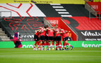 SOUTHAMPTON, ENGLAND - OCTOBER 04: Saints huddle during the Premier League match between Southampton and West Bromwich Albion at St Mary's Stadium on October 04, 2020 in Southampton, United Kingdom. Sporting stadiums around the UK remain under strict restrictions due to the Coronavirus Pandemic as Government social distancing laws prohibit fans inside venues resulting in games being played behind closed doors. (Photo by Matt Watson/Southampton FC via Getty Images)