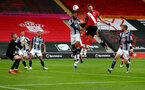 SOUTHAMPTON, ENGLAND - OCTOBER 04: Jan Bednarek(R) of Southampton wins a header during the Premier League match between Southampton and West Bromwich Albion at St Mary's Stadium on October 04, 2020 in Southampton, United Kingdom. Sporting stadiums around the UK remain under strict restrictions due to the Coronavirus Pandemic as Government social distancing laws prohibit fans inside venues resulting in games being played behind closed doors. (Photo by Matt Watson/Southampton FC via Getty Images)