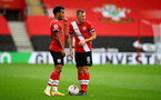 SOUTHAMPTON, ENGLAND - OCTOBER 04: Ryan Bertrand(L) and James Ward-Prowse during the Premier League match between Southampton and West Bromwich Albion at St Mary's Stadium on October 04, 2020 in Southampton, United Kingdom. Sporting stadiums around the UK remain under strict restrictions due to the Coronavirus Pandemic as Government social distancing laws prohibit fans inside venues resulting in games being played behind closed doors. (Photo by Matt Watson/Southampton FC via Getty Images)