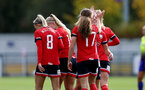 SOUTHAMPTON, ENGLAND - OCTOBER 11: southampton players congratulate Lucia Kendall (center) on her goal during FAWNL match between Southampton Women and Exeter City at Snows Stadium on October 11, 2020 in Southampton, England. (Photo by Isabelle Field/Southampton FC via Getty Images)