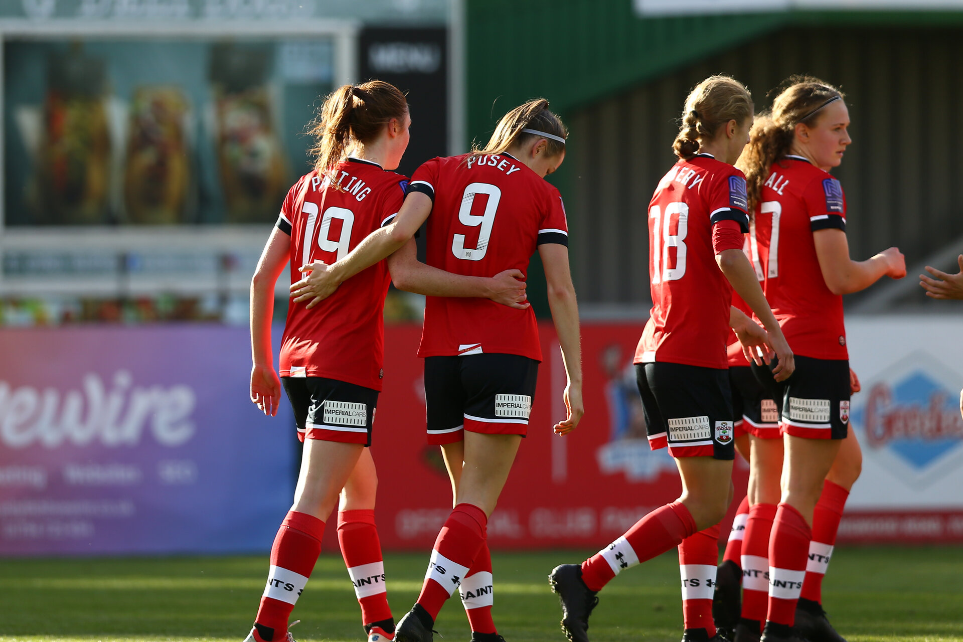 SOUTHAMPTON, ENGLAND - OCTOBER 11: Ella Pusey (R) of Southampton congratulating Rachel Panting (L) on her goal during FAWNL match between Southampton Women and Exeter City at Snows Stadium on October 11, 2020 in Southampton, England. (Photo by Isabelle Field/Southampton FC via Getty Images)
