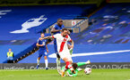 LONDON, ENGLAND - OCTOBER 17:  Danny Ings (center) of Southampton knocking the ball past Kepa Arrizabalaga (R) of Chelsea to score saints first goal during the Premier League match between Chelsea and Southampton at Stamford Bridge on October 17, 2020 in London, United Kingdom. Sporting stadiums around the UK remain under strict restrictions due to the Coronavirus Pandemic as Government social distancing laws prohibit fans inside venues resulting in games being played behind closed doors. (Photo by Matt Watson/Southampton FC via Getty Images)