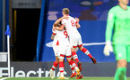 LONDON, ENGLAND - OCTOBER 17: Southampton players celebrate Ché Adams goal during the Premier League match between Chelsea and Southampton at Stamford Bridge on October 17, 2020 in London, United Kingdom. Sporting stadiums around the UK remain under strict restrictions due to the Coronavirus Pandemic as Government social distancing laws prohibit fans inside venues resulting in games being played behind closed doors. (Photo by Matt Watson/Southampton FC via Getty Images)