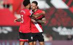 SOUTHAMPTON, ENGLAND - OCTOBER 25: Ryan Bertrand(L) of Southampton and Danny Ings(R) of Southampton ahead of the Premier League match between Southampton and Everton at St Mary's Stadium on October 25, 2020 in Southampton, England. Sporting stadiums around the UK remain under strict restrictions due to the Coronavirus Pandemic as Government social distancing laws prohibit fans inside venues resulting in games being played behind closed doors. (Photo by Matt Watson/Southampton FC via Getty Images)