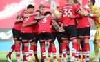 SOUTHAMPTON, ENGLAND - OCTOBER 25: Southampton players huddle ahead of the Premier League match between Southampton and Everton at St Mary's Stadium on October 25, 2020 in Southampton, England. Sporting stadiums around the UK remain under strict restrictions due to the Coronavirus Pandemic as Government social distancing laws prohibit fans inside venues resulting in games being played behind closed doors. (Photo by Matt Watson/Southampton FC via Getty Images)