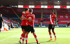 SOUTHAMPTON, ENGLAND - OCTOBER 25: James Ward-Prowse(center) of Southampton and Kyle Walker-Peters(R) of Southampton congratulate Ché Adams(L) on his goal during the Premier League match between Southampton and Everton at St Mary's Stadium on October 25, 2020 in Southampton, England. Sporting stadiums around the UK remain under strict restrictions due to the Coronavirus Pandemic as Government social distancing laws prohibit fans inside venues resulting in games being played behind closed doors. (Photo by Matt Watson/Southampton FC via Getty Images)