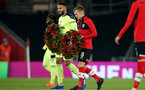 SOUTHAMPTON, ENGLAND - NOVEMBER 06: Jamaal Lascelles(L) of Newcastle and James Ward-Prowse(L) of Southampton both carrying out a poppy wreath for remembrance Sunday ahead of the Premier League match between Southampton and Newcastle United at St Mary's Stadium on November 06, 2020 in Southampton, England. Sporting stadiums around the UK remain under strict restrictions due to the Coronavirus Pandemic as Government social distancing laws prohibit fans inside venues resulting in games being played behind closed doors. (Photo by Matt Watson/Southampton FC via Getty Images)