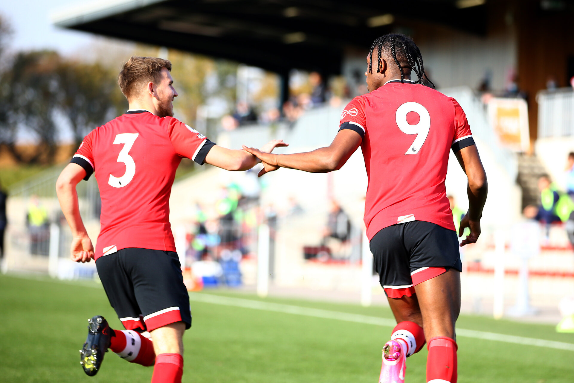 SOUTHAMPTON, ENGLAND - NOVEMBER 07: Dan N'Lundulu(R) of Southampton celebrates his first goal with Jake Vokins(L) of Southampton during the Premier League 2 match between Southampton FC B Team and Manchester City at Staplewood Training Ground on November 07, 2020 in Southampton, England. (Photo by Isabelle Field/Southampton FC via Getty Images) (Photo by Isabelle Field/Isabelle Field)