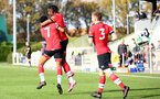 SOUTHAMPTON, ENGLAND - NOVEMBER 07: Dan N'Lundulu of Southampton celebrates his goal with his team mates during the Premier League 2 match between Southampton FC B Team and Manchester City at Staplewood Training Ground on November 07, 2020 in Southampton, England. (Photo by Isabelle Field/Southampton FC via Getty Images) (Photo by Isabelle Field/Isabelle Field)